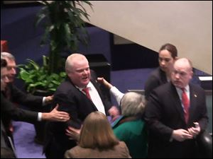 Toronto Mayor Rob Ford is shown in a video frame grab as he knocks down Councillor Pam McConnell as he ran toward hecklers in the audience at City Hall Monday.