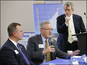 Dr. Orman Hall, director of Gov. John Kasich's Healthy Ohio office, speaks as Ohio Attorney General Mike DeWine, right, and state Rep. Robert Sprague listen during a forum at the Emergency Services Training Center on Jefferson in downtown Toledo.