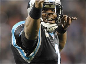 Carolina Panthers' Cam Newton (1) reacts after making a first down against the New England Patriots during the first half of an NFL football game in Charlotte, N.C., Monday, Nov. 18, 2013. (AP Photo/Mike McCarn)