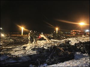Firefighters and rescuers work at the crash site of a Russian passenger airliner near Kazan, the capital of the Tatarstan republic, about 450 miles east of Moscow, Sunday.
