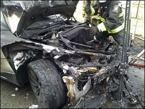 Emergency workers respond to a fire on a Tesla Model S electric car in Smyrna, Tenn., on Nov. 6.