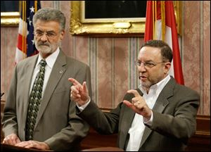 Cleveland Browns CEO Joe Banner, right, speaks during a news conference with Cleveland Mayor Frank Jackson, left, at City Hall today, Nov. 19, 2013.