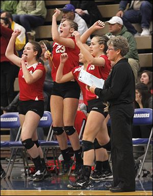 Bedford head coach Jodi Manore remains calm as her bench reacts to a point.