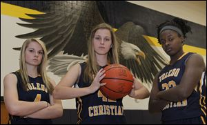 Toledo Christian finished 20-4 last season and looks to repeat as Toldeo Area Athletic Conference champion with top players, from left, Darian Westmeyer, Faith Johnson, and Camille Gist.