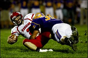 Wauseon quarterback Ty Suntken is sacked by Bryan linebacker Jake Jones. Jones leads the team in tackles this season. The Golden Bears won the NWOAL title for the second straight year.