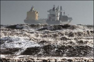 Two tankers are battered by gale winds while at the roadstead in the rough waters of the Gulf of Cagliari, Sardinia.