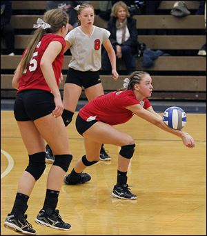 Bedford's Nicole Rightnowar returns the ball.