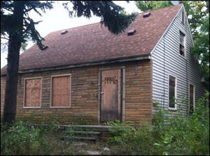 Eminem's childhood home in Detroit, Mich., as pictured on his album covers.