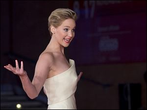 Actress Jennifer Lawrence gestures to photographers as she arrives for the screening of the movie 'The Hunger Games: Catching Fire', at the 8th edition of the Rome International Film Festival, in Rome last Thursday.