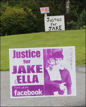 'Justice for JAKE' signs along State Rt. 269 in Castalia were part of a campaign by the Jacob Limberios family. He died in March, 2012, of a gunshot wound to the head, now ruled accidental.