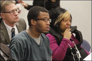 Kei'ron Toyer, 17, with his mother, Ebony Toyer, listens to the sentencing proceedings in Lucas County Juvenile Court. The Sylvania Southview student pleaded no contest to rape.
