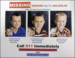 A missing-persons poster issued a year ago that shows age-progression portraits of Andrew, left, Alexander, and Tanner Skelton.
