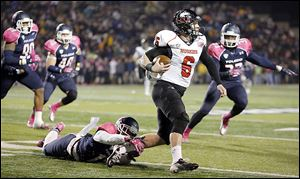 Northern Illinois quarterback Jordan Lynch eludes UT's Cheatham Norrils. Lynch threw for 202 yards and rushed for 161.