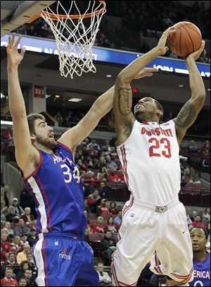 Ohio State's Amir Williams, who had a career-high 16 points, shoots over American's Tony Wroblicky.
