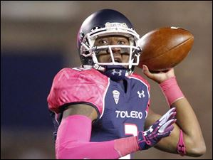 University of Toledo QB Terrance Owens (2) throws the ball.