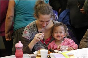 A'naysia Scott, 15 months, and her mother Mary Cervantez,enjoy lunch during the event at Holy Trinity Greek Orthodox Church.