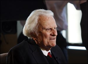 Billy Graham, shown here in 2010, has been returned home after hospital tests.