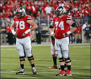 Ohio State's Andrew Norwell, left, and Jack Mewhort catch their breath Sept. 28 against Wisconsin. Mewhort, a St. John's Jesuit graduate, will play his final game at Ohio Stadium on Saturday.