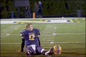 Bryan's Austin Schimmoeller sits dejected after the game. He threw for 370 yards and three touchdowns and ran for three TDs.