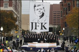 The U.S. Naval Academy Glee Club performs during the ceremony to mark the 50th anniversary of John F. Kennedy's assassination in Dealey Plaza in Dallas.