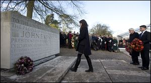 Tatiana Schlossberg, granddaughter of President John F. Kennedy, lays a wreath at his memorial at Runnymede, England. The memorial overlooks the site of the signing of the Magna Charta.
