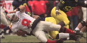 Ohio State Stanley Jackson is sacked by Michigan's Dhani Jones. Jackson, an OSU quarterback in the 1990s will be a special guest at the Blanchard Avenue Pentecostal Church of God.
