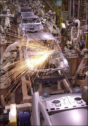 Robots weld the frames of Ford Mustangs at the company's facility in Flat Rock, Mich. The plant builds another popular car for Ford, the Fusion.