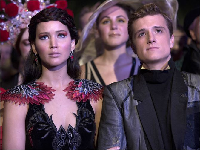 Film Review The Hunger Games Catching Fire Jennifer Lawrence as Katniss Everdeen, left, and Josh Hutcherson as Peeta Mellark in a scene from 'The Hunger Games: Catching Fire.'