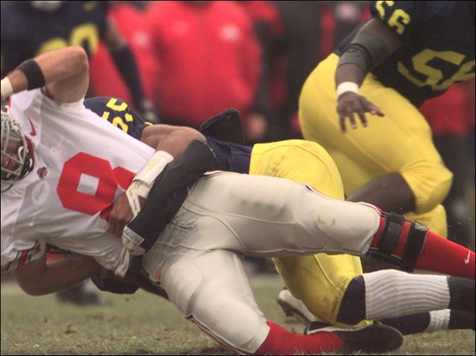 SPT OSU JACKSON SACK Ohio State Stanley Jackson is sacked by Michigan's Dhani Jones. Jackson, an OSU quarterback in the 1990s will be a special guest at the Blanchard Avenue Pentecostal Church of God.