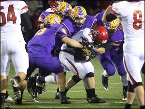 Bryan's defensive line stops the ball and a Kenton player.