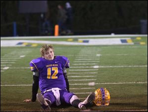 Bryan's quarterback Austin Schimmoeller (12) sits on the field after losing the Friday.