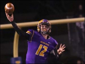 Bryan's quarterback Austin Schimmoeller (12) finds an opening down the field in the first quarter.