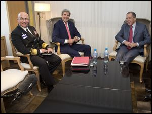 From left, U.S. Navy Vice Admiral Kurt Tidd, U.S. Secretary of State John Kerry, and Russian foreign minister Sergei Lavrov meet before talks on Iran's nuclear program in Geneva.