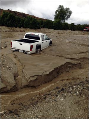 Flooding, mud and debris strike San Timoteo Canyon Road in Redlands, Calif. Firefighters responded to dozens of calls of weather-related traffic collisions, flooding and mudslides spurred by Thursday's downpour in southern California.