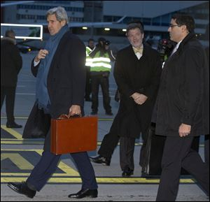 U.S. Secretary of State John Kerry arrives at Geneva International airport in Switzerland today for the Iran nuclear talks.