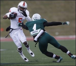 BGSU's Ronnie Moore is defended by EMU's Willie Creear III during game at EMU's Rynearson Stadium in Ypsilanti, Mich.