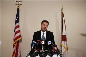 Congressman Trey Radel addresses the media at his office in Cape Coral on Wednesday night.
