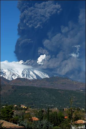 Smoke billows from the Mount Etna, Europe's tallest active volcano, Sicily today.