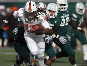 BGSU's Travis Green is chased by EMU defenders.