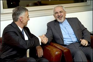 Switzerland's Foreign Minister Didier Burkhalter, left, talks with Mohammad-Javad Zarif, Iranian foreign minister, before negotiations.