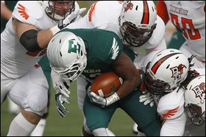 Eastern Michigan's  Ryan Brumfield is brought down by swarm of BG defenders. Eastern Michigan had  just 29 yards of offense.