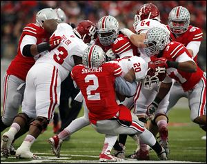 Ohio State's Ryan Shazier stops D'Angelo Roberts. Indiana was held scoreless until the fourth quarter.