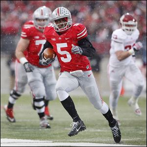 Ohio State's Braxton Miller scores a touchdown against Indiana during the first  quarter. He threw for two scores and ran for two others. The Buckeyes improved to 11-0 on the season.
