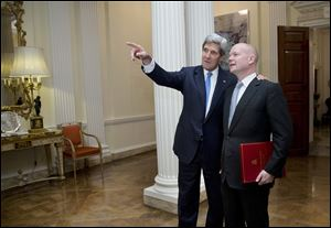 U.S. Secretary of State John Kerry, left, talks with British Foreign Secretary William Hague at the residence of the U.S. Ambassador to Britain, in London. Mr. Kerry arrived in the U.K. after two days of talks in Geneva.