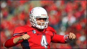 Fresno State quarterback Derek Carr celebrates one of his seven touchdown passes against New Mexico on Saturday in Fresno, Calif.