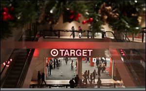 Holiday trimmings greet shoppers around the main entry of a Target on Saturday in New York.