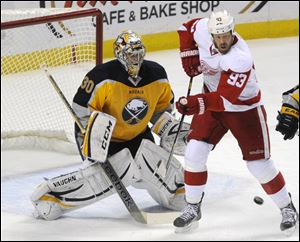 Sabres goaltender Ryan Miller reacts as Detroit Red Wings right winger Johan Franzen tries to deflect the puck Sunday in Buffalo, N.Y.