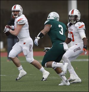 BGSU quarterback Matt Johnson is chased by EMU's Donald Coleman.