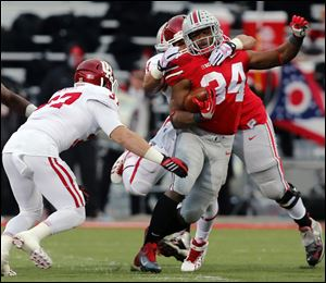 Ohio State RB Carlos Hyde (34) runs the ball against Indiana  during the second quarter of a football game Saturday.