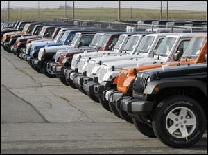 Jeep Wranglers are lined up at Chrysler's Toledo North Assembly plant.